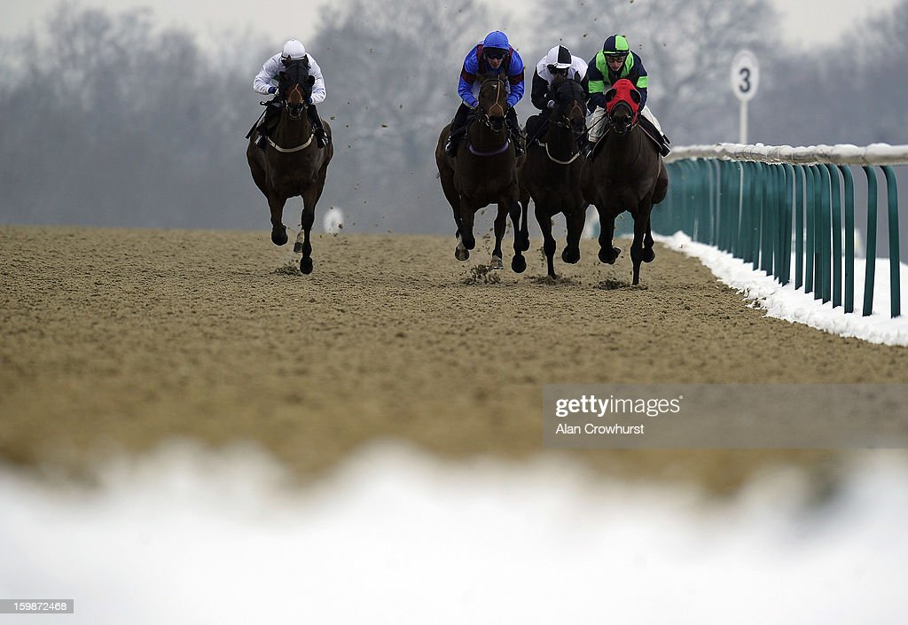 Luke Morris riding Where's Reiley (2R) turn into the straight to win The Stay At The Marriott Hotel Selling Stakes at Lingfield racecourse on January 22, 2013 in Lingfield, England.