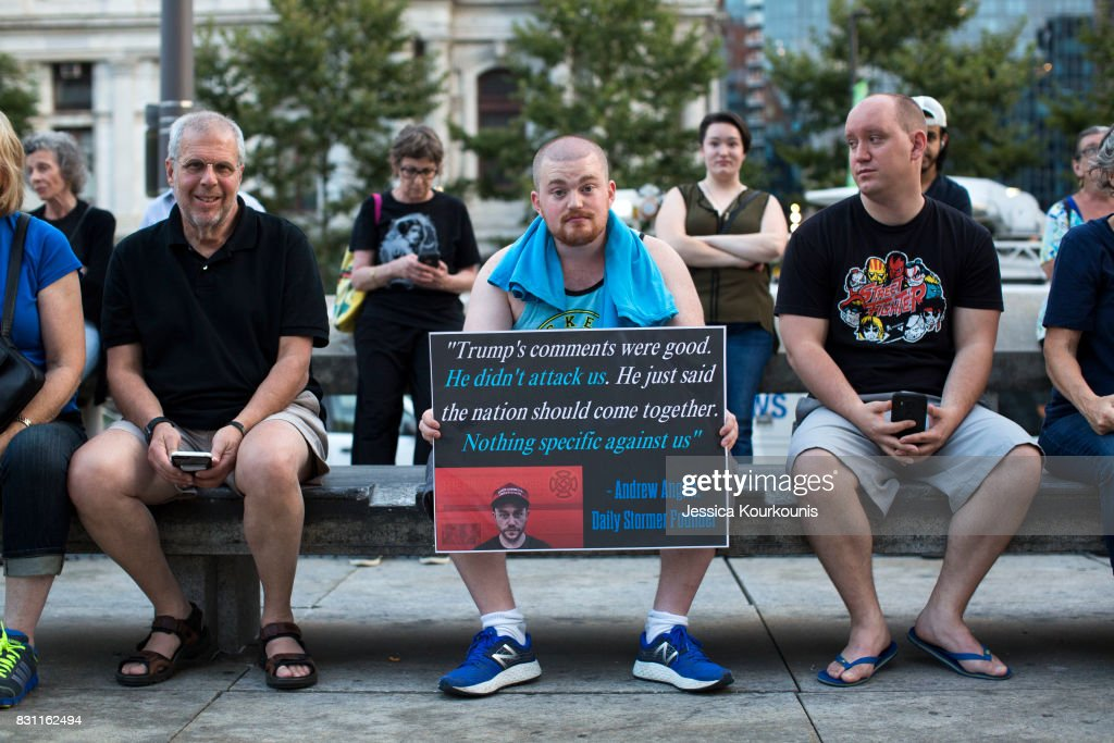 Luke Mueller, center, attends a vigil in downtown Philadelphia on August 13, 2017 in support of the victims of violence at the 'Unite the Right' rally In Charlottesville, Virginia this weekend. Vigils are being held across the country following clashes between white supremacists and counter-protestors in Charlottesville, Virginia on Saturday, August 12th. Heather Heyer, 32, was killed in Charlottesville when a car allegedly driven by James Alex Fields Jr. barreled into a crowd of counter-protesters following violence at the 'Unite the Right' rally.