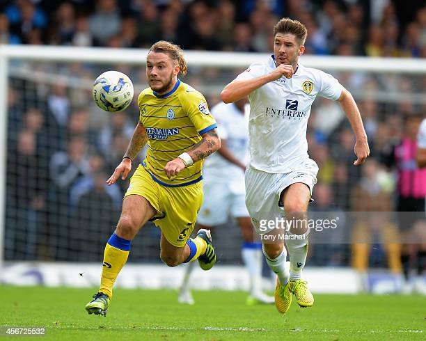 Luke Murphy of Leeds United chases Stevie May of Sheffield Wednesday during the Sky Bet Championship match between Leeds United and Sheffield...