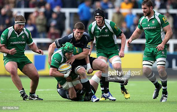 Luke Narraway of London Irish is tackled by Will Welch and Mark Wilson during the Aviva Premiership match between Newcastle Falcons and London Irish...