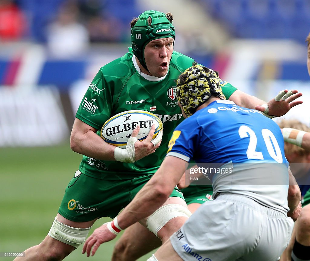 <a gi-track='captionPersonalityLinkClicked' href=/galleries/search?phrase=Luke+Narraway&family=editorial&specificpeople=564173 ng-click='$event.stopPropagation()'>Luke Narraway</a> #6 of the London Irish carries the ball as <a gi-track='captionPersonalityLinkClicked' href=/galleries/search?phrase=Kelly+Brown+-+Rugby+Player&family=editorial&specificpeople=211000 ng-click='$event.stopPropagation()'>Kelly Brown</a> #20 of Saracens defends during the Aviva Premiership match on March 12, 2016 at Red Bull Arena in Harrison, New Jersey.