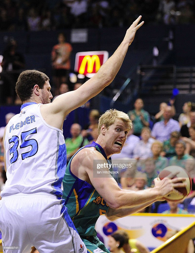 Luke Nevill of Crocodiles looks to get past Alex Pledger of the Breakers during the round 14 NBL match between the Townsville Crocodiles and the New Zealand Breakers at Townsville Entertainment Centre on January 11, 2013 in Townsville, Australia.