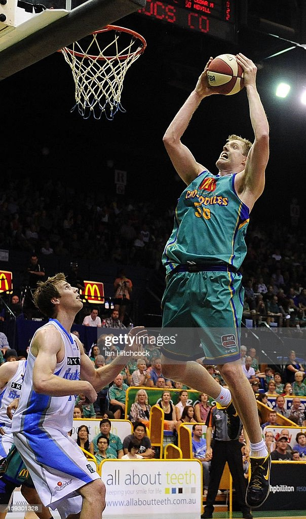 <a gi-track='captionPersonalityLinkClicked' href=/galleries/search?phrase=Luke+Nevill&family=editorial&specificpeople=835195 ng-click='$event.stopPropagation()'>Luke Nevill</a> of the Crocodiles attempts a layup during the round 14 NBL match between the Townsville Crocodiles and the New Zealand Breakers at Townsville Entertainment Centre on January 11, 2013 in Townsville, Australia.