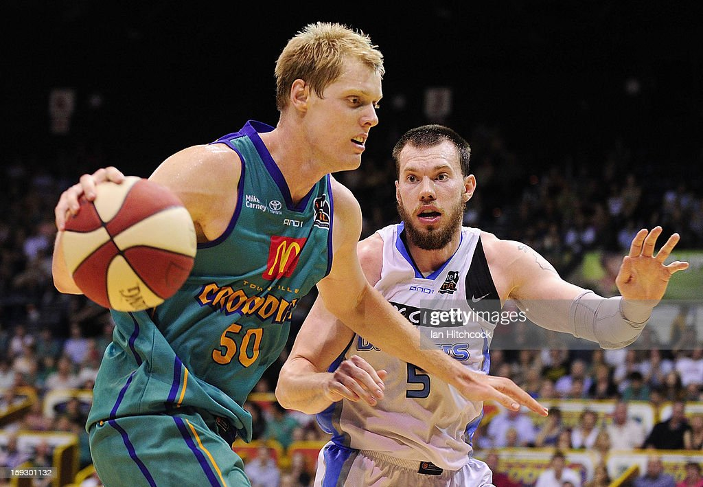 Luke Nevill of the Crocodiles looks to get past Will Hudson of the Breakers during the round 14 NBL match between the Townsville Crocodiles and the New Zealand Breakers at Townsville Entertainment Centre on January 11, 2013 in Townsville, Australia.