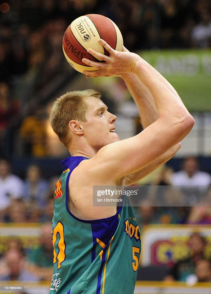 <a gi-track='captionPersonalityLinkClicked' href=/galleries/search?phrase=Luke+Nevill&family=editorial&specificpeople=835195 ng-click='$event.stopPropagation()'>Luke Nevill</a> of the Crocodiles makes a free throw attempt during the round ten NBL match between the Townsville Crocodiles and the Melbourne Tigers at Townsville Entertainment Centre on December 8, 2012 in Townsville, Australia.