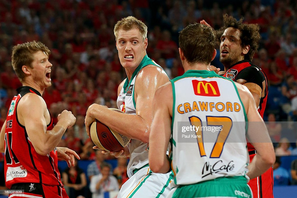 Luke Nevill of the Crocodiles rebounds during the round 16 NBL match between the Perth Wildcats and the Townsville Crocodiles at Perth Arena on January 25, 2013 in Perth, Australia.