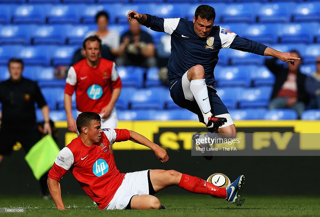 Luke Noble of the Army FA tackles <a gi-track='captionPersonalityLinkClicked' href=/galleries/search?phrase=Graeme+Murty&family=editorial&specificpeople=635314 ng-click='$event.stopPropagation()'>Graeme Murty</a> of the FA Legends during the Army FA and FA Legends Match at Madejski Stadium on May 18, 2013 in Reading, England.