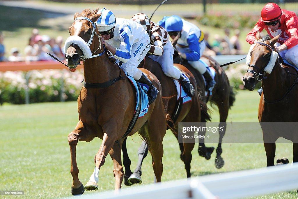 Luke Nolan riding Genuine Spin wins the Alternate Railway Handicap during Melbourne racing at Moonee Valley Racecourse on December 29, 2012 in Melbourne, Australia.