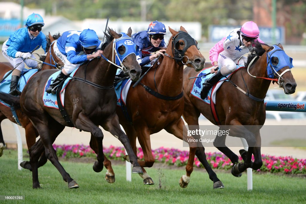 Luke Nolan riding Grand Daughter wins the Sportingbet Handicap from John Kissick riding Hot Testa and Rebecca Williams riding Captain Smith during Melbourne racing at Moonee Valley Racecourse on January 25, 2013 in Melbourne, Australia.