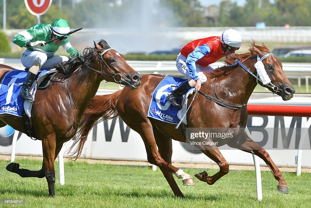 Luke Nolan riding Mulaazem (R) wins the Hyland Race Colours Autumn Stakes from <a gi-track='captionPersonalityLinkClicked' href=/galleries/search?phrase=Glen+Boss&family=editorial&specificpeople=194758 ng-click='$event.stopPropagation()'>Glen Boss</a> riding Fiveandahalfstar during Melbourne Racing at Caulfield Racecourse on February 9, 2013 in Melbourne, Australia.