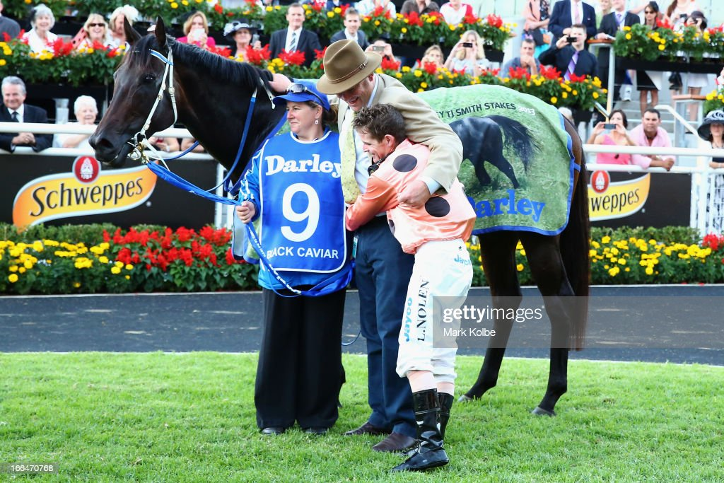 Luke Nolan who rode 'Black Caviar' to win race 9 the Darley TJ Smith Stakes poses in the mounting yard with handler Donna Fisher and trainer Peter Moody on Australian Derby Day at Royal Randwick Racecourse on April 13, 2013 in Sydney, Australia.