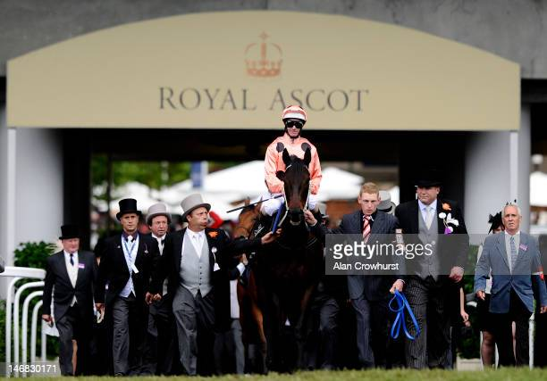 Luke Nolen riding Black Caviar makes his way to the start ahead of the Diamond Jubilee Stakes during day five of Royal Ascot at Ascot racecourse on...