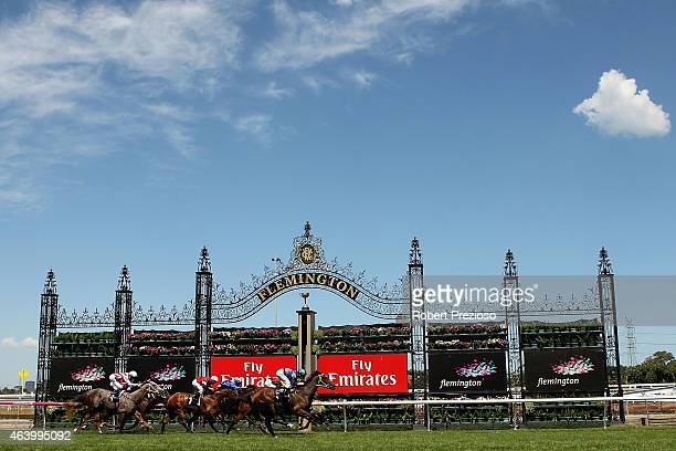 Luke Nolen riding Sweet and Speedy crosses the line to win race 2 The Vanity during Melbourne racing on February 21 2015 in Melbourne Australia