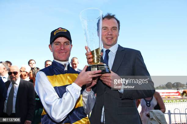 Luke Nolen with Aaron Purcell after Aloisia won the Schweppes Thousand Guineas during Melbourne Racing on Caulfield Guineas Day at Caulfield...