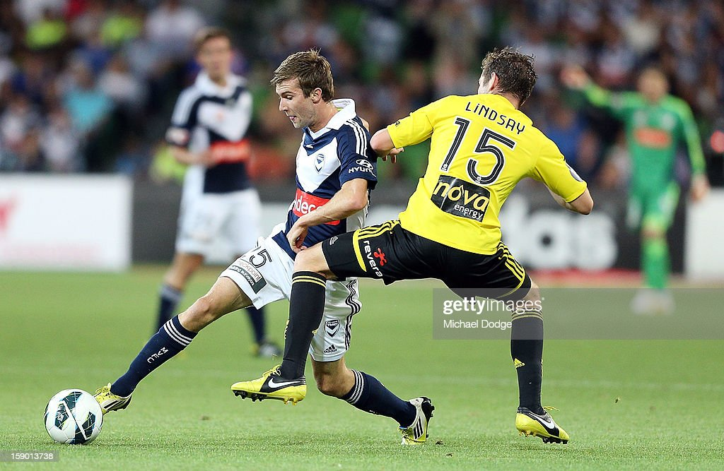 Luke O'Dea (L) of the Melbourne Victory contests for the ball with Cameron Lindsay of the Wellington Phoenix after the round 15 A-League match between the Melbourne Victory and Wellington Phoenix at AAMI Park on January 5, 2013 in Melbourne, Australia.