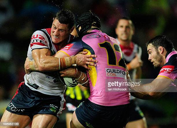 Luke O'Donnell of the Roosters is tackled by Gavin Cooper of the Cowboys during the round 10 NRL match between the North Queensland Cowboys and the...