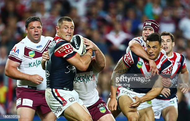 Luke O'Donnell of the Roosters is tackled during the NRL Qualifying Final match between the Sydney Roosters and the Manly Warringah Sea Eagles at...