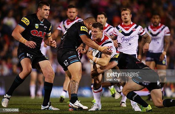 Luke O'Donnell of the Roosters is tackled during the round 21 NRL match between the Penrith Panthers and the Sydney Roosters at Centrebet Stadium on...