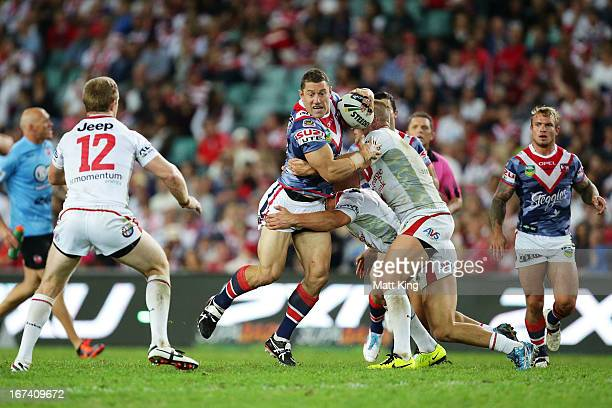 Luke O'Donnell of the Roosters is tackled during the round seven NRL match between the Sydney Roosters and the St George Illawarra Dragons at Allianz...