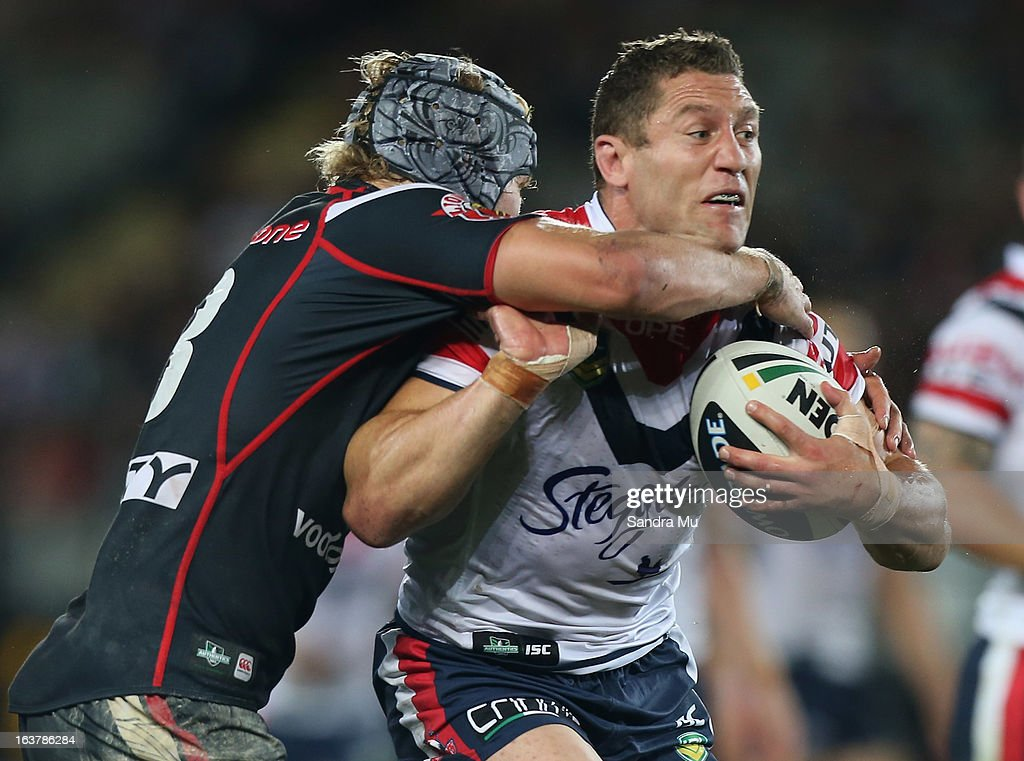 Luke O'Donnell of the Roosters is tackled during the round two NRL match between the New Zealand Warriors and the Sydney Roosters at Eden Park on March 16, 2013 in Auckland, New Zealand.