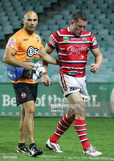 Luke O'Donnell of the Roosters leaves the field with a knee injury during the NRL trial match between the Sydney Roosters and the Wests Tigers at...