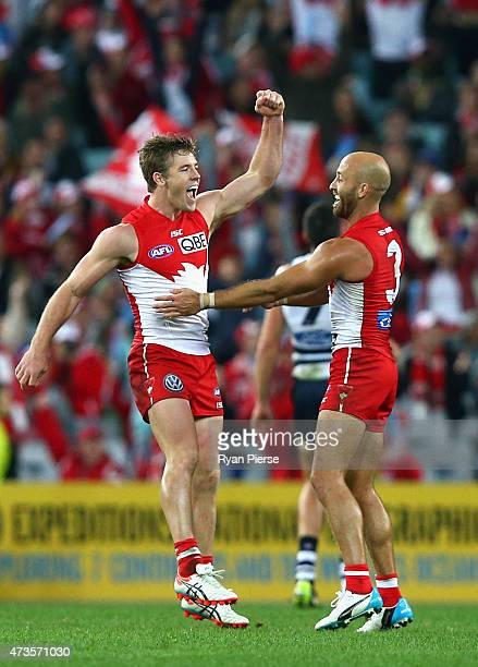 Luke Parker and Jarrad McVeigh of the Swans celebrate a goal during the round seven AFL match between the Sydney Swans and the Geelong Cats at ANZ...
