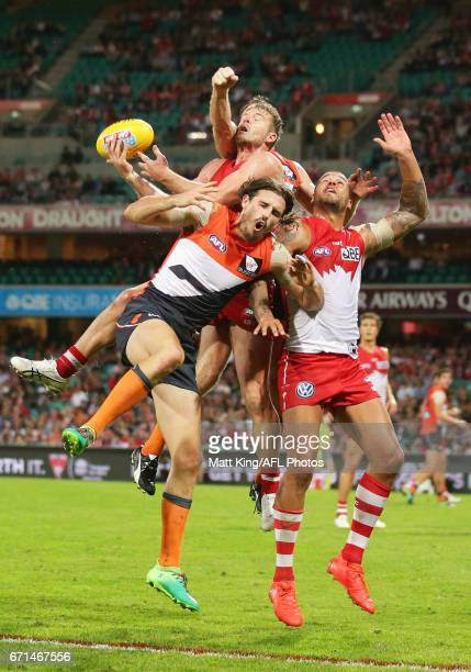 Luke Parker and Lance Franklin of the Swans competes for the ball against Phil Davis of the Giants during the round five AFL match between the Sydney...