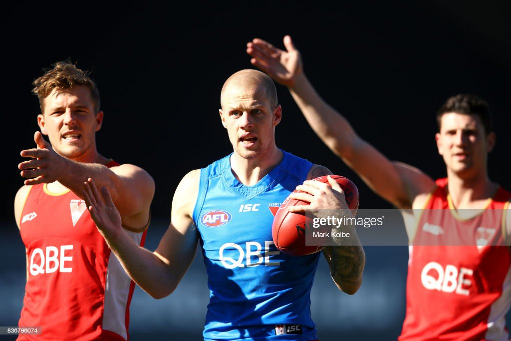 Luke Parker and Zac Jones appeal to the coaching staff after winning a drill during a Sydney Swans AFL training session at Sydney Cricket Ground on August 22, 2017 in Sydney, Australia.