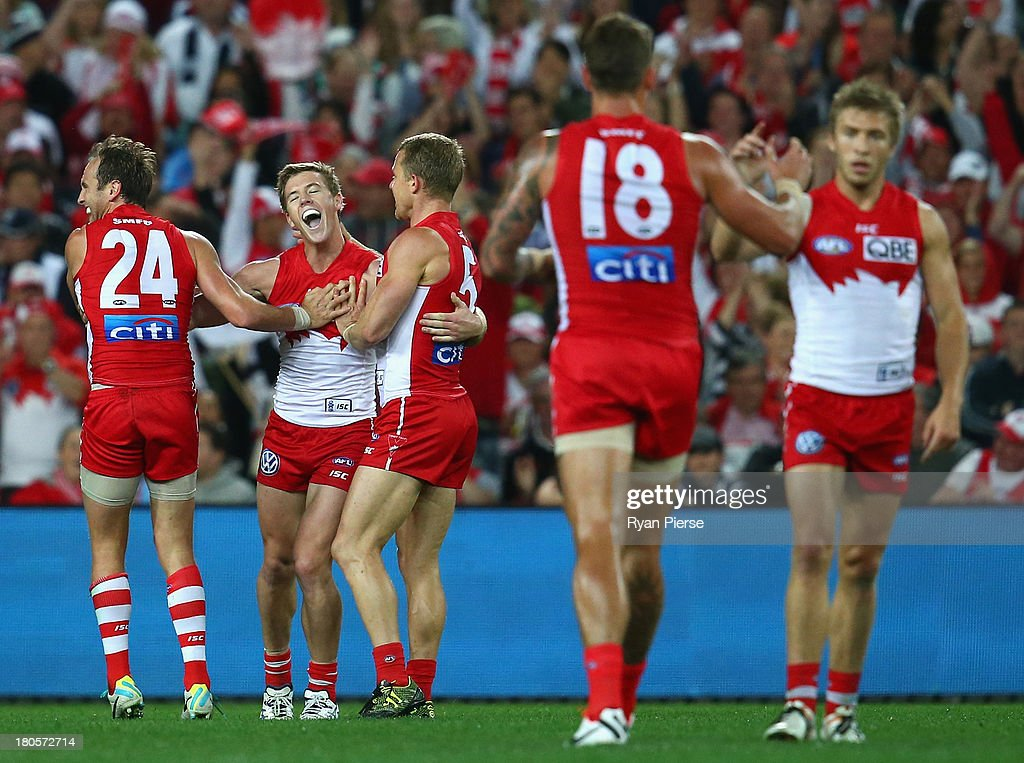 Luke Parker of the Swans celebrates a goal during the AFL First Semi Final match between the Sydney Swans and the Carlton Blues at ANZ Stadium on September 14, 2013 in Sydney, Australia.