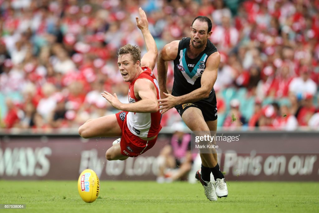 Luke Parker of the Swans falls as he competes for the ball with Matthew Broadbent of the Power during the round one AFL match between the Sydney Swans and the Port Adelaide Power at Sydney Cricket Ground on March 25, 2017 in Sydney, Australia.