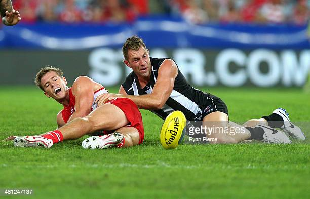 Luke Parker of the Swans is tackled by Travis Cloke of the Magpies during the round two AFL match between the Sydney Swans and the Collingwood...