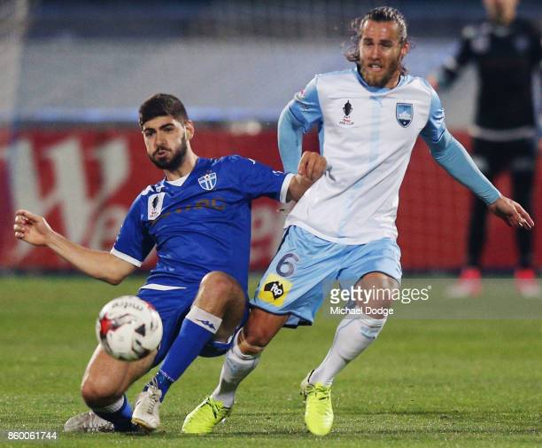 Luke Pavlou of South Melbourne and Joshua Brillante of Sydney FC compete for the ball during the FFA Cup Semi Final match between South Melbourne FC...