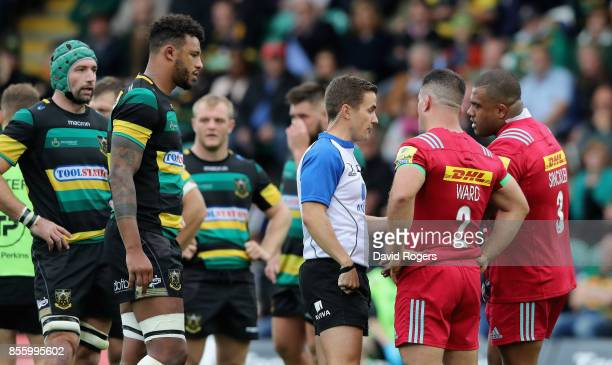 Luke Pearce the referee talks to Harlequins captain Dave Ward as a penalty is awarded against Kyle Sinckler for an alleged eye guaging on...