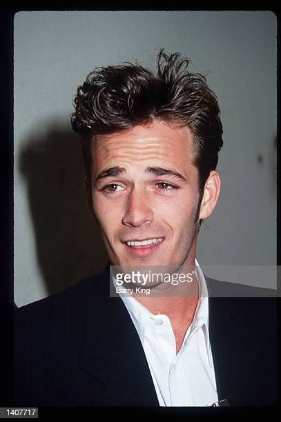 Luke Perry attends the first annual MTV Movie Awards June 6 1992 in Los Angeles CA The show combined performances with award presentations and...