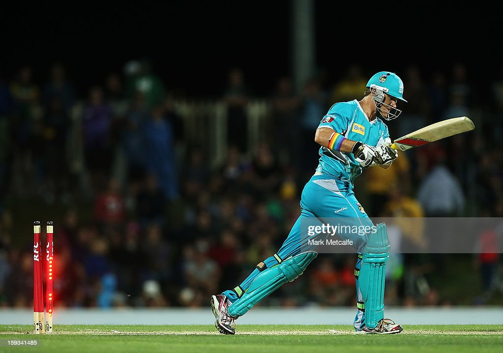 <a gi-track='captionPersonalityLinkClicked' href=/galleries/search?phrase=Luke+Pomersbach&family=editorial&specificpeople=4042492 ng-click='$event.stopPropagation()'>Luke Pomersbach</a> of the Heat is bowled by Ben Laughlin of the Hurricanes during the Big Bash League match between the Hobart Hurricanes and the Brisbane Heat at Blundstone Arena on January 12, 2013 in Hobart, Australia.