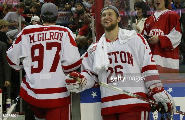 Luke Popko of the Boston Terriers celebrates the win with teammate Matt Gilroy after the game against the Miami Red Hawks during the NCAA Men's...