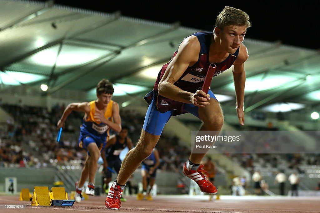 Luke Purdy of Queensland starts the mens u18 4x100 metre relay during day two of the Australian Junior Championships at the WA Athletics Stadium on March 13, 2013 in Perth, Australia.