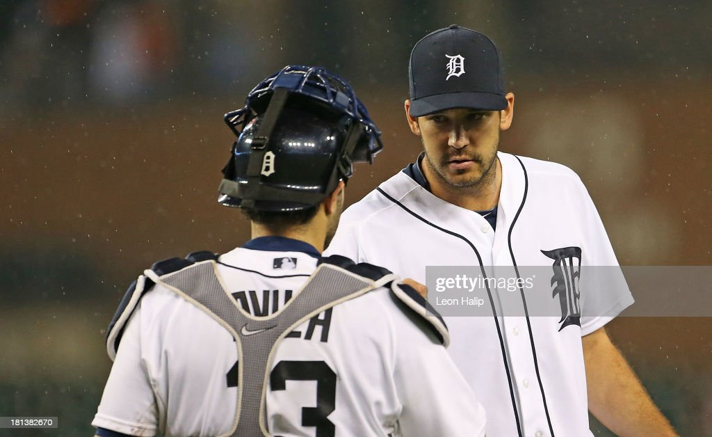 Luke Putkonen #36 and <a gi-track='captionPersonalityLinkClicked' href=/galleries/search?phrase=Alex+Avila&family=editorial&specificpeople=5749211 ng-click='$event.stopPropagation()'>Alex Avila</a> #13 of the Detroit Tigers celebrate a win over the Chicago White Sox at Comerica Park on September 20, 2013 in Detroit, Michigan. The Tigers defeated the Sox 12-5.