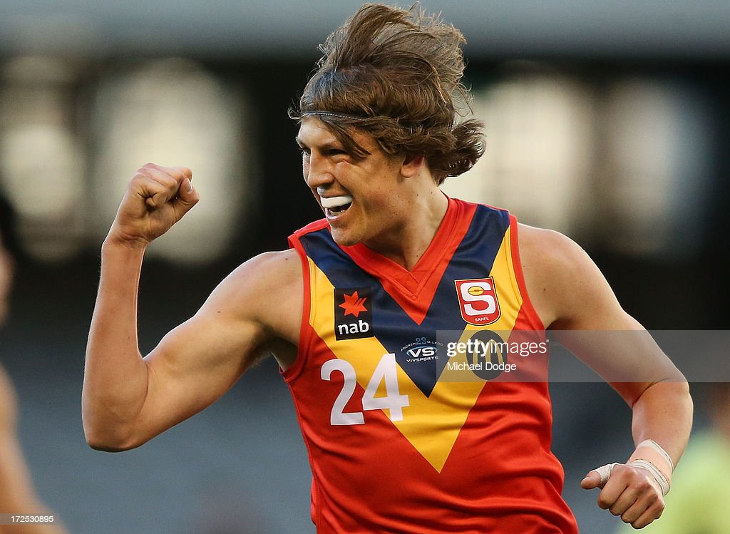 Luke Reynolds of South Australia celebrates a goal during the AFL Under 18s Championship match between South Australia and Western Australia at Etihad Stadium on July 3, 2013 in Melbourne, Australia.