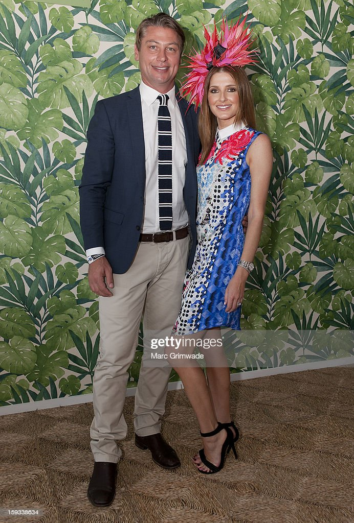 Luke Ricketson and Kate Waterhouse pose in the Moet & Chandon marquee on Magic Millions Raceday at the Gold Coast Turf Club on January 12, 2013 in Gold Coast, Australia.