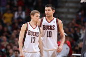 Luke Ridnour and Carlos Delfino of the Milwaukee Bucks walk down the court during the game against the Atlanta Hawks on April 12 2010 at the Bradley...