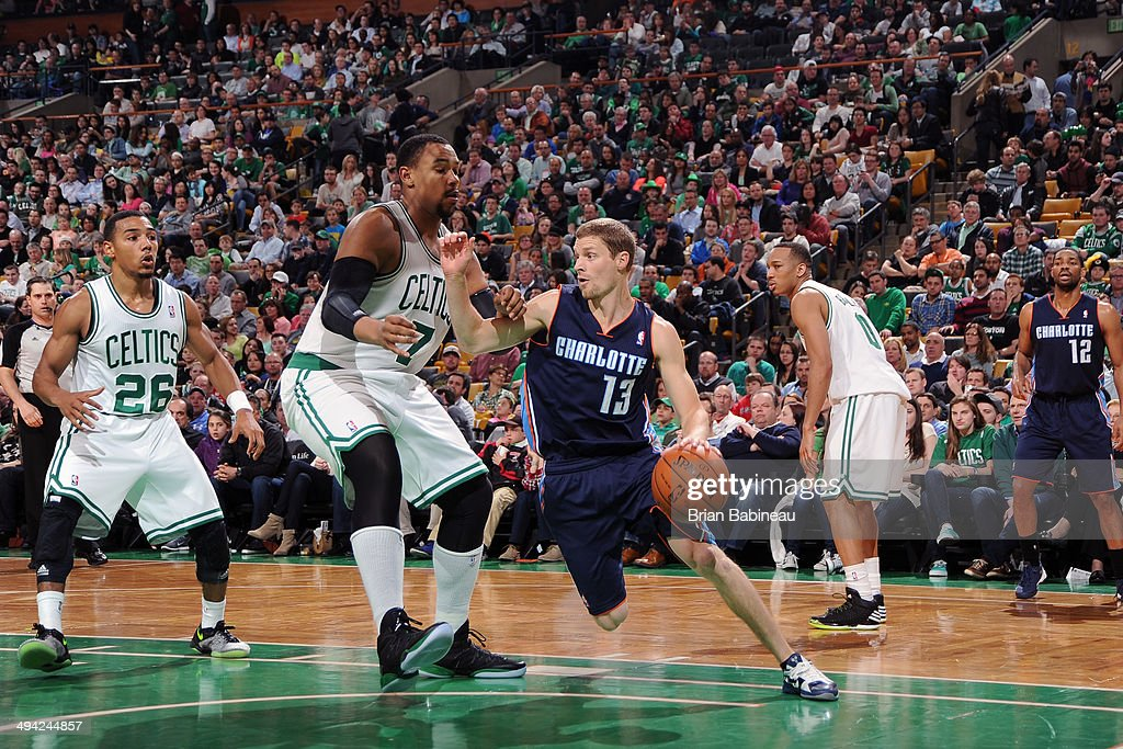 <a gi-track='captionPersonalityLinkClicked' href=/galleries/search?phrase=Luke+Ridnour&family=editorial&specificpeople=201824 ng-click='$event.stopPropagation()'>Luke Ridnour</a> #13 of the Charlotte Bobcats drives against <a gi-track='captionPersonalityLinkClicked' href=/galleries/search?phrase=Jared+Sullinger&family=editorial&specificpeople=6866665 ng-click='$event.stopPropagation()'>Jared Sullinger</a> #7 of the Boston Celtics on April 11, 2014 at the TD Garden in Boston, Massachusetts.
