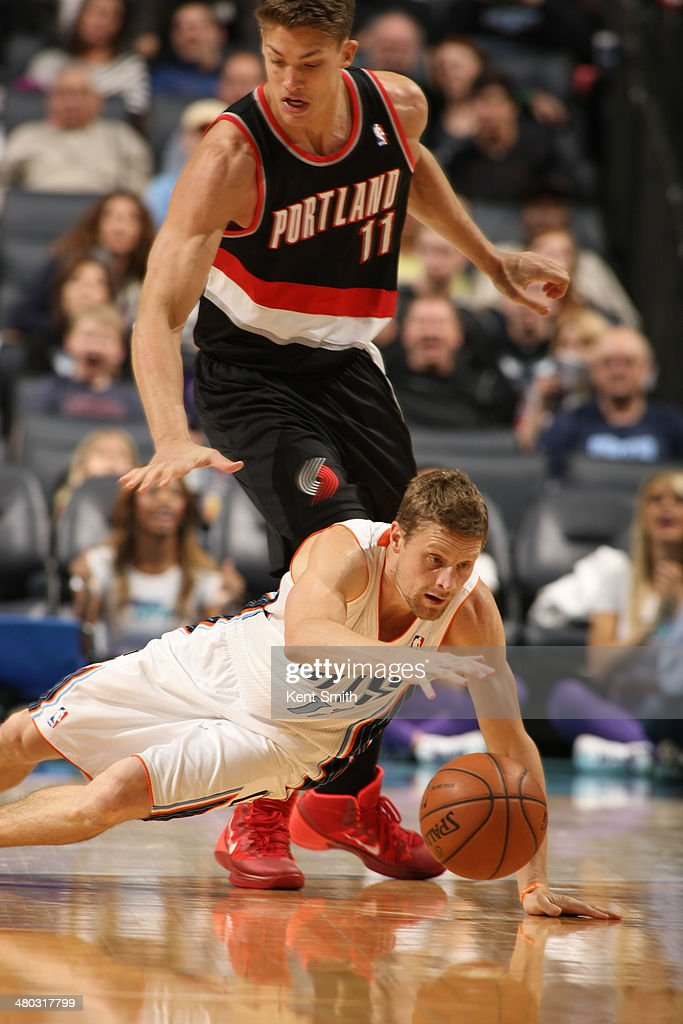 Luke Ridnour #13 of the Charlotte Bobcats goes for the ball against the Portland Trail Blazers during the game at the Time Warner Cable Arena on March 22, 2014 in Charlotte, North Carolina.