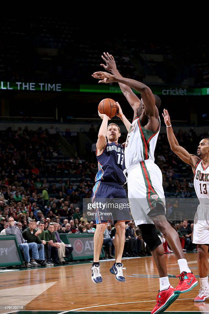 Luke Ridnour #13 of the Charlotte Bobcats shoots against (L-R) Ekpe Udoh #5 and Ramon Sessions #13 of the Milwaukee Bucks on March 16, 2014 at the BMO Harris Bradley Center in Milwaukee, Wisconsin.