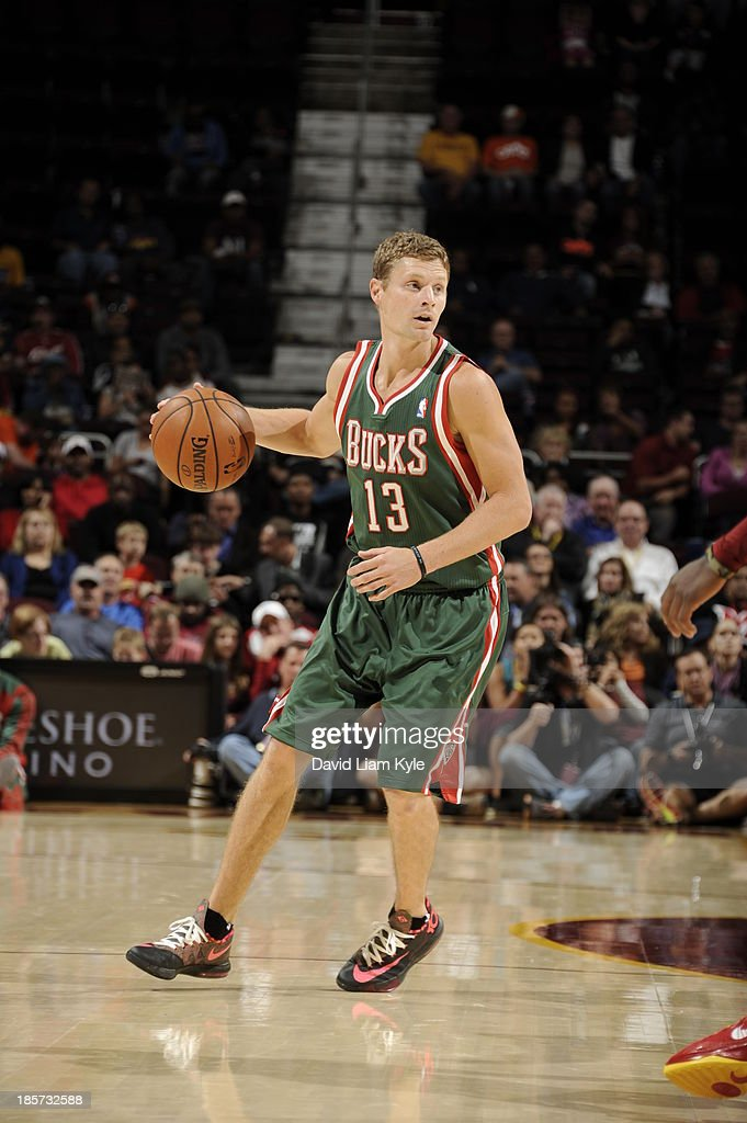 <a gi-track='captionPersonalityLinkClicked' href=/galleries/search?phrase=Luke+Ridnour&family=editorial&specificpeople=201824 ng-click='$event.stopPropagation()'>Luke Ridnour</a> #13 of the Milwaukee Bucks brings the ball up court against the Cleveland Cavaliers at The Quicken Loans Arena on October 8, 2013 in Cleveland, Ohio.