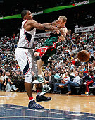 Luke Ridnour of the Milwaukee Bucks is fouled hard by Joe Johnson of the Atlanta Hawks during Game Five of the Eastern Conference Quarterfinals of...