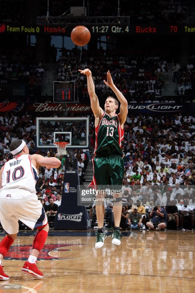 <a gi-track='captionPersonalityLinkClicked' href=/galleries/search?phrase=Luke+Ridnour&family=editorial&specificpeople=201824 ng-click='$event.stopPropagation()'>Luke Ridnour</a> #13 of the Milwaukee Bucks shoots a jump shot against <a gi-track='captionPersonalityLinkClicked' href=/galleries/search?phrase=Mike+Bibby&family=editorial&specificpeople=201503 ng-click='$event.stopPropagation()'>Mike Bibby</a> #10 of the Atlanta Hawks in Game One of the Eastern Conference Quarterfinals during the 2010 NBA Playoffs at Philips Arena on April 17, 2010 in Atlanta, Georgia. The Hawks won 102-92.