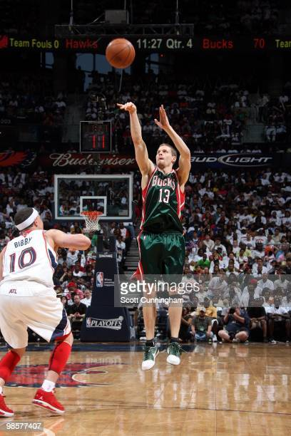 Luke Ridnour of the Milwaukee Bucks shoots a jump shot against Mike Bibby of the Atlanta Hawks in Game One of the Eastern Conference Quarterfinals...