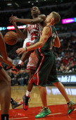 Luke Ridnour of the Milwuakee Bucks knocks the ball away from Marquis Teague of the Chicago Bulls during a preseason game at the United Center on...