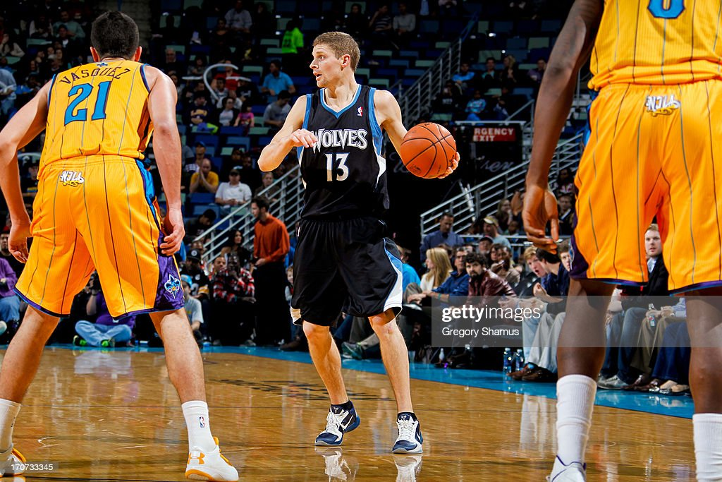 <a gi-track='captionPersonalityLinkClicked' href=/galleries/search?phrase=Luke+Ridnour&family=editorial&specificpeople=201824 ng-click='$event.stopPropagation()'>Luke Ridnour</a> #13 of the Minnesota Timberwolves controls the ball against <a gi-track='captionPersonalityLinkClicked' href=/galleries/search?phrase=Greivis+Vasquez&family=editorial&specificpeople=4066977 ng-click='$event.stopPropagation()'>Greivis Vasquez</a> #21 of the New Orleans Hornets on December 14, 2012 at the New Orleans Arena in New Orleans, Louisiana.
